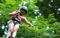 A young camper ziplining.